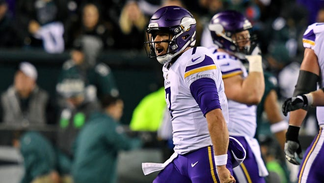 Minnesota Vikings quarterback Case Keenum (7) celebrates after throwing a touchdown  pass during the first quarter against the Philadelphia Eagles in the NFC Championship game at Lincoln Financial Field.