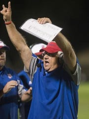 Pace's Mickey Lindsey calls out plays in his final game coaching the Pace Patriots.