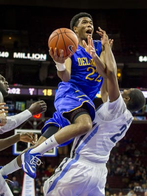 Delaware's Cazmon Hayes collides with Villanova's Kris Jenkins as he goes up for a shot at the Wells Fargo Center in a 2014-15 game.