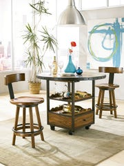 A rustic wood bistro set accented in metal has space for wine bottles, glasses and cocktail napkins and can be moved from room to room.