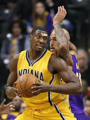 Indiana Pacers center Ian Mahinmi (28) puts a spin move on Los Angeles Lakers center Robert Sacre (50) in the second half of their game. The Indiana Pacers host the Los Angeles Lakers Monday, Feb8, 2016, evening at Bankers Life Fieldhouse. The Pacers defeated the Lakers 89-87.