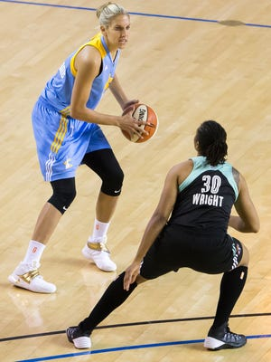 Chicago's Elena Delle Donne looks for room to pass the ball past New York's Tanisha Wright in the second half of Chicago's 93-59 win over the New York Liberty at the Bob Carpenter Center in Newark on Sunday afternoon.