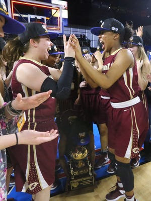 Riverdale's Hope Hinson (00) and Alasia Hayes (1)  celebrate their Class AAA state championship.