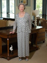 Marjorie Mounts wears a silver mesh-style  formal dress and matching jacket by R&M Richards from Macy's and silver sling-back heels from LifeStride.