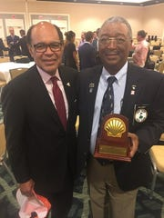 Billy Brent, right, holding his award with former First Tee national director Joe Louis Barrow Jr., son of the famed boxer, at the banquet where Brent was named First Tee Volunteer of the Year.