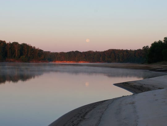Moonrise over the Apalachicola River. The river is