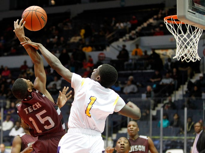 Edison Tech's Quinton Bedell, left, is fouled by East High's Raliek Redd battling for a rebound at the Blue Cross Arena.