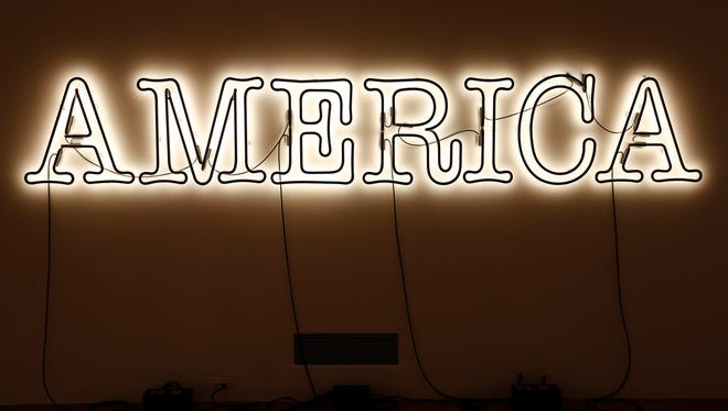 """Glenn Ligon's """"America"""" in neon and paint is part of, Cincinnati Art Museum presents 30 Americans,  exhibition focuses on issues of racial, gender, and historical identity in contemporary culture, while exploring the powerful influence of artistic legacy and community across generations. The approximately 60 artworks are drawn primarily from the acclaimed Rubell Family Collection of Miami, as well as from the Cincinnati Art Museum's permanent collection."""