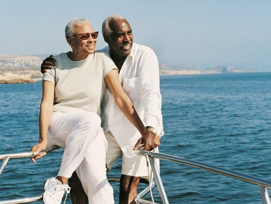 senior-couple-on-sailboat_large.jpg