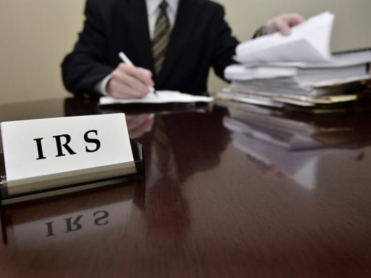 Irs Tax Auditor At Desk