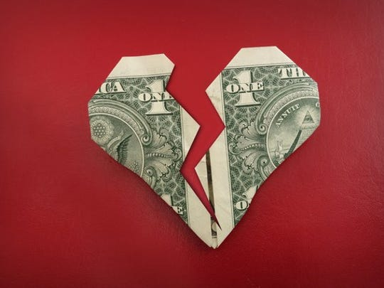 a heart formed by folding a dollar that has been cut in two