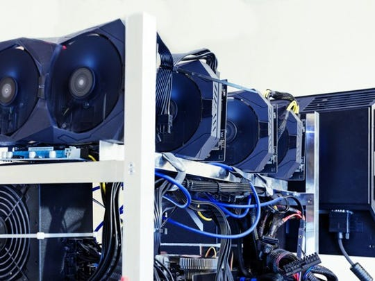 Hard drives and graphics cards are connected to a monitor in order to mine, or create, cryptocurrencies.