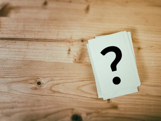 026-question-mark-on-wooden-table_large.jpg