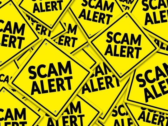 a bunch of yellow signs that say scam alert, all criss crossed and lying on top of another