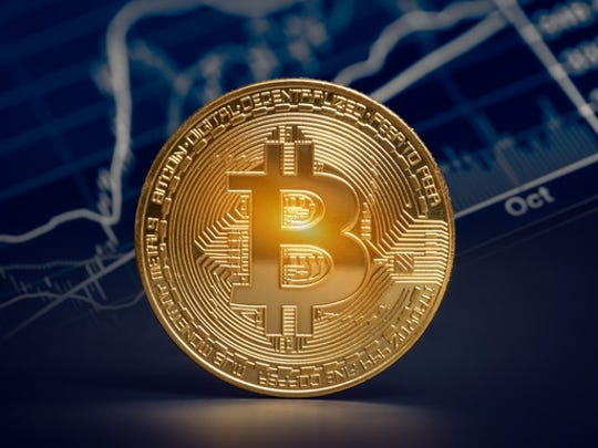 Gold coin with bitcoin symbol.