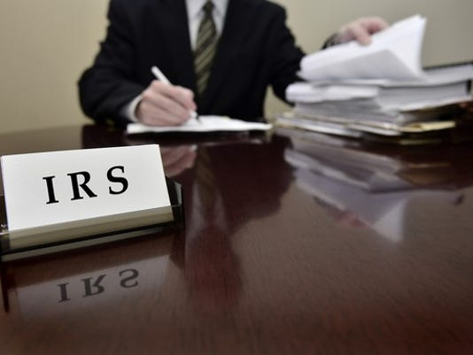 irs-tax-auditor-at-desk-getty_large.jpg