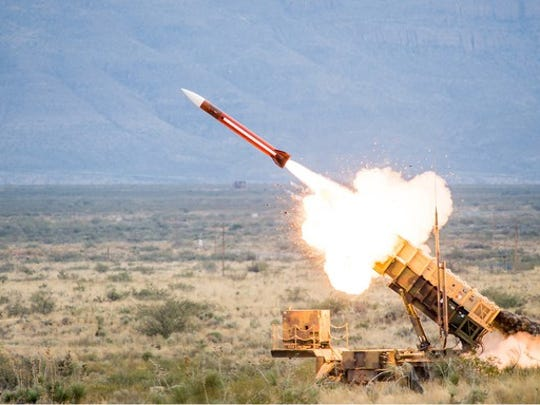 Raytheon Patriot Missile in action in a field.