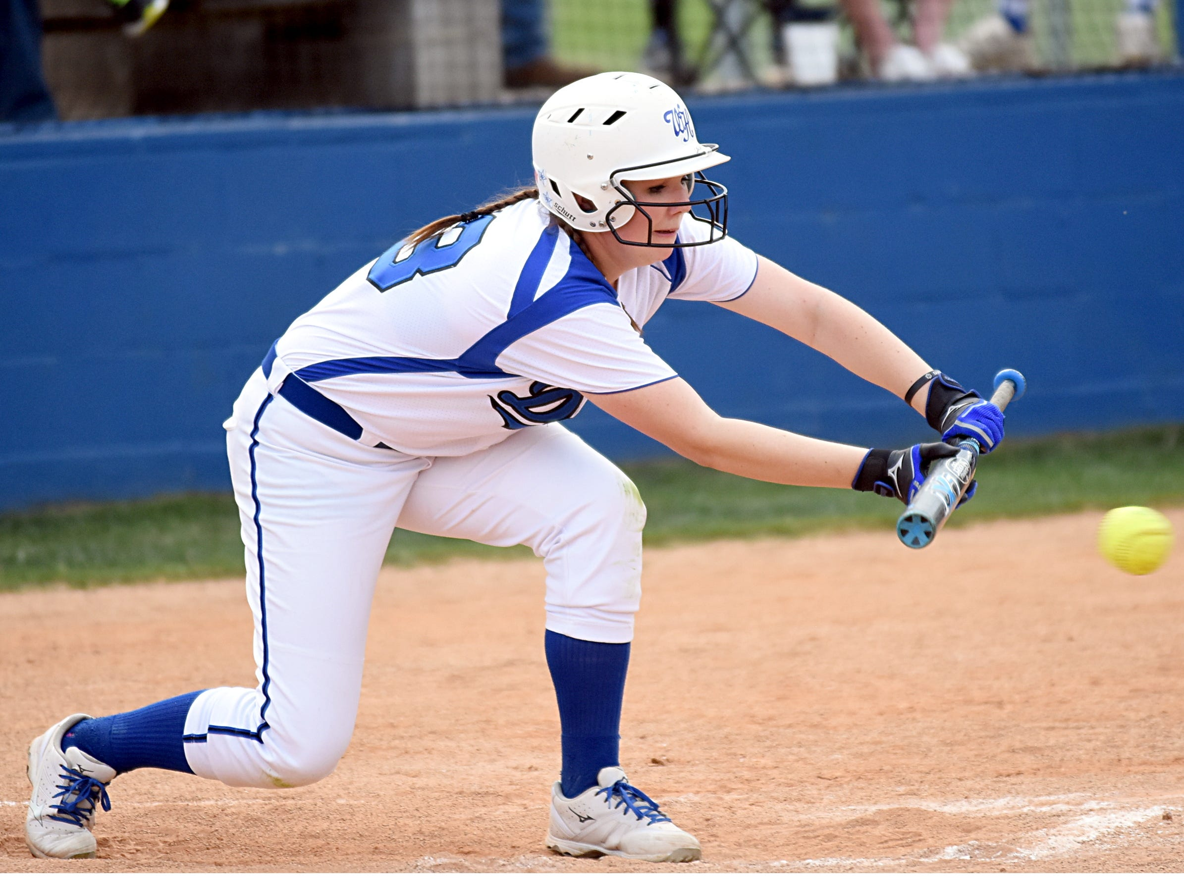 White House High senior Kaite Williams attempts to lay down a second-inning bunt. Williams scored a run during the four-run second inning.