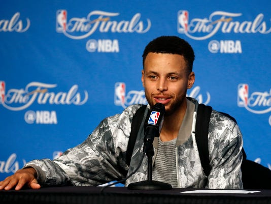 Golden State Warriors guard Stephen Curry speaks after Game 3 of basketball's NBA Finals between the Warriors and the Cleveland Cavaliers in Cleveland, early Thursday, June 8, 2017. (AP Photo/Ron Schwane)