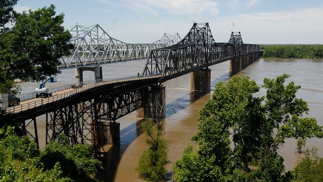 Water rushes under the Mississippi River bridges at Vicksburg.