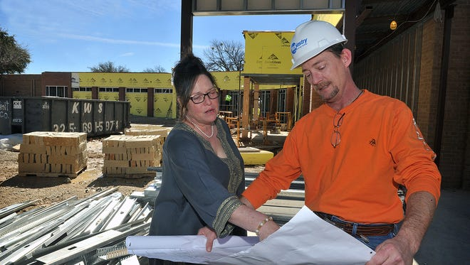 Seymour Hospital Administrator Leslie Hardin talks with Will Happney, construction superintendent, about progress on a major expansion at the hospital. Seymour Hospital was named  one of the top 100 rural hospitals in America.