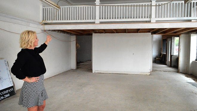 Amber Schacter, the new owner of the Zales Building in downtown Wichita Falls, talks about plans to extend the left and middle sections of a mezzanine and enclose it for storage and heating and air conditioning. The restaurateur has plans to put in three eateries: The Carat Bar and Bistro, Ganache To Go and The Morris Supper Club.