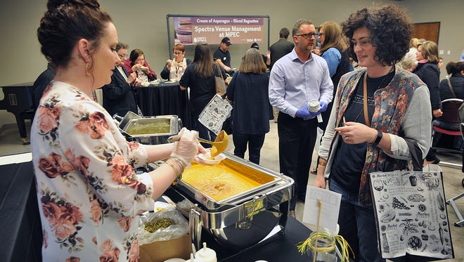 Kathryn Hager tries a sample of roasted pumpkin soup from Chartwells Tuesday morning at the 6th Annual Empty Bowls event at the Wichita Falls Museum of Art at Midwestern State University.