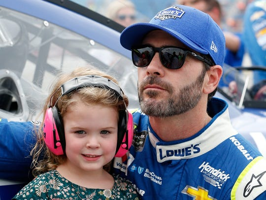 JOLIET, IL - SEPTEMBER 17:  Jimmie Johnson, driver of the #48 Lowe's Chevrolet, shares a moment with his daughter, Lydia, on the grid prior to the Monster Energy NASCAR Cup Series Tales of the Turtles 400 at Chicagoland Speedway on September 17, 2017 in Joliet, Illinois.  (Photo by Brian Lawdermilk/Getty Images) ORG XMIT: 775017553 ORIG FILE ID: 848514448