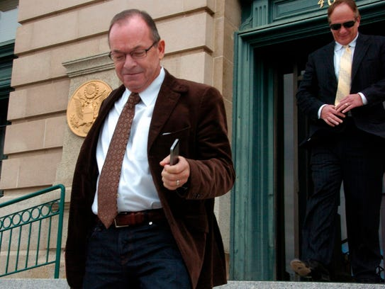 Tim Blixseth, left, leaves the U.S. courthouse in Butte,