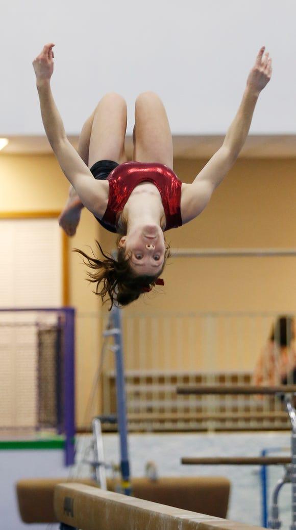 McCutcheon gymnast Megan Walker practices on the balance