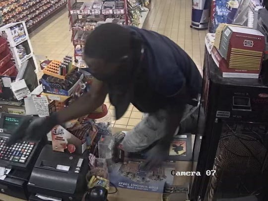 One of two suspects in the robbery of Kwik Sak on Lowry