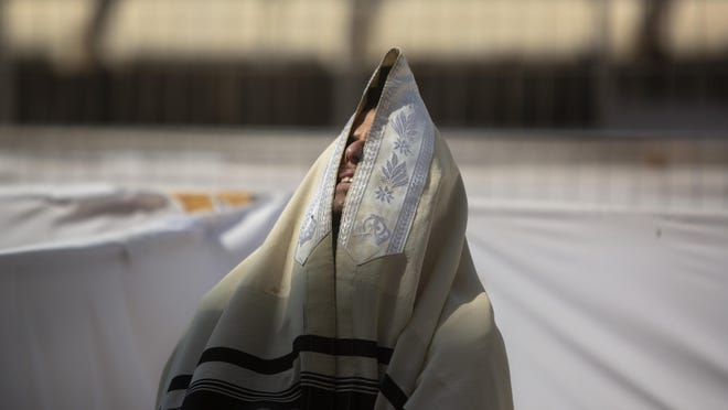 An ultra-Orthodox Jewish man prays ahead of the Jewish new year at the Western Wall, the holiest site where Jews can pray in Jerusalem's old city, Wednesday, Sept. 16, 2020.