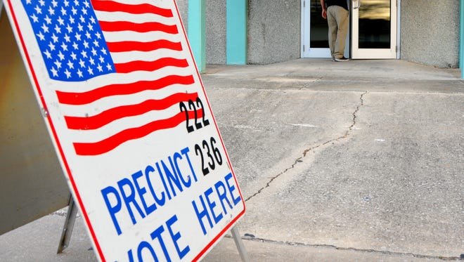 A voter heads into Ramp Road Recreation Center in Cocoa Beach.