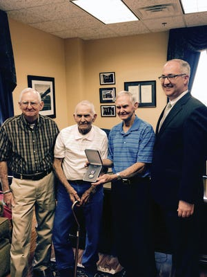 Brothers to WWII hero Alfred Bennett Hill, Jr. accept Silver Star.  From left:  Jerry Wayne Hill, Edwin Earl Hill and Thomas Franklin Hill, with Sen. Thad Cochran's State Director Brad White.
