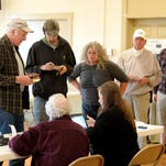 Voters stand in line and wait to be processed before casting their votes  at the Middlebrook voting precinct on Tuesday, Nov. 4, 2014.