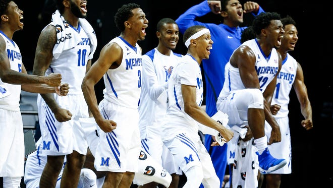 University of Memphis teammates celebrate on the bench during a 101-78 over LeMoyne-Owen at the FedExForum in Memphis, Tenn., Thursday, November 2, 2017.
