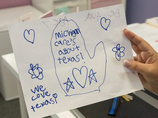 Children who brought donations to Tailwaggers send messages to flood victims in Texas.