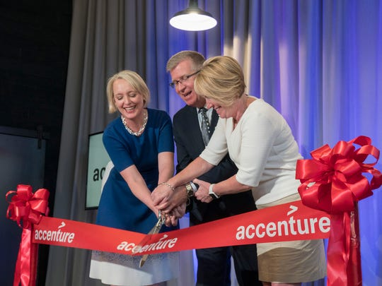 Accenture CEO Julie Sweet, CEO of Michigan Economic Development Corporation Jeff Mason and State Rep. Laura Cox cut the ceremonial ribbon.