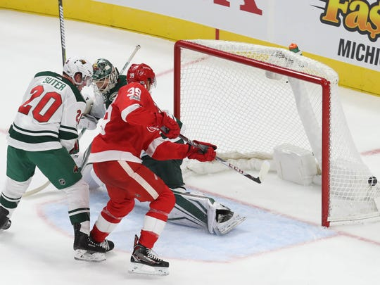 Red Wings' Anthony Mantha scores the first goal at Little Caesars Arena past Minnesota Wild goalie Devan Dubnyk in the second period in Detroit, Thursday, Oct. 5, 2017.