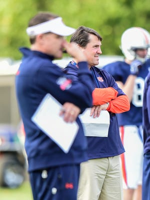 Auburn defensive coordinator Will Muschamp watches practice.