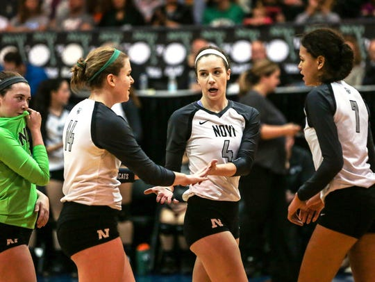 Novi players (from left) Claire Pinkerton, Erin O'Leary,