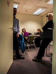 Burlington School Board member Jeff Wick closes the door for an executive session at an emergency board meeting -- which Wick originally refused to participate in maintaining it was illegal -- at Burlington's school district office late Sunday night, April 1, 2018.