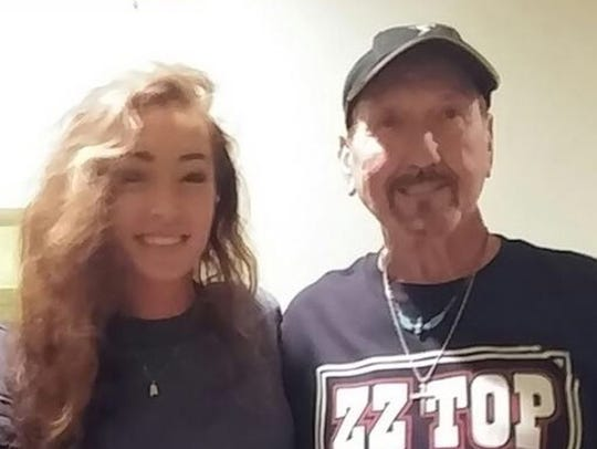 Donica Knight takes a photo with James Burton.