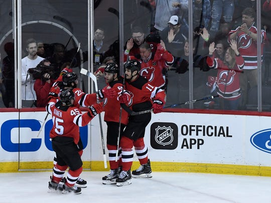 New Jersey Devils left wing Taylor Hall (9) celebrates his goal with the team in the second period against the Tampa Bay Lightning during Game 3 of Round 1 of the Stanley Cup Playoffs at the Prudential Center in Newark, NJ on Monday, April 16, 2018.
