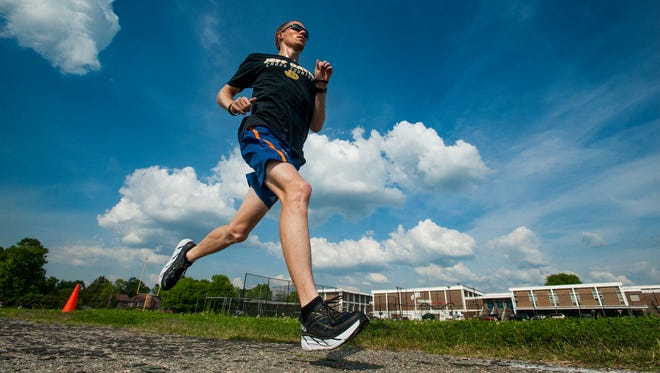 Alan Ash, cross country coach at Jeff Davis High School, runs in Montgomery, Ala., on Tuesday April 11, 2017, as he trains to run in the Boston Marathon.