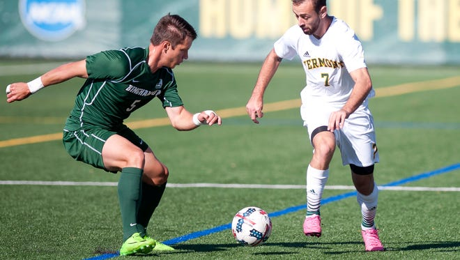 Vermont's Justin Freitas, right, looks to dribble past Binghamton's Kevin Flesch during Saturday's men's soccer game at Virtue Field.