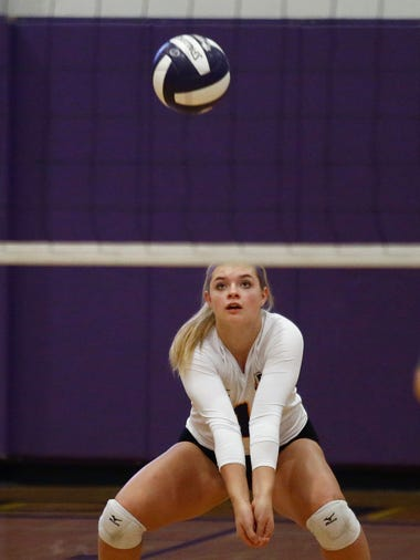 Indianola senior Regan Bishop receives a serve. Class