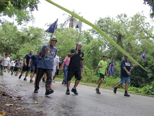Juan Guzman, front left, an 80-year-old World War II survivor from Santa Rita, and others participate in the survivors' walk to the site of the Manengon concentration camp in Yona on July 27, 2011. A memorial ceremony and Mass was held to celebrate the day the Chamorro people were freed from the Manengon concentration camp, and to honor victims of all WWII locations of significance including Chagui'an, Asinan, Pigo, Fena, Faha, Tinta, As Mateo, Umafit, and Mata.