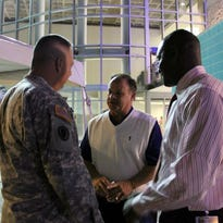 Tampa Bay Storm President Derrick Brooks and player personnel director David Wilson (center), chat with a military member.