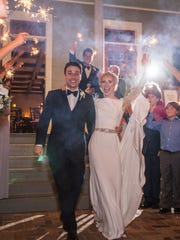 Mr. and Mrs. Raffaele Marino leave the reception at